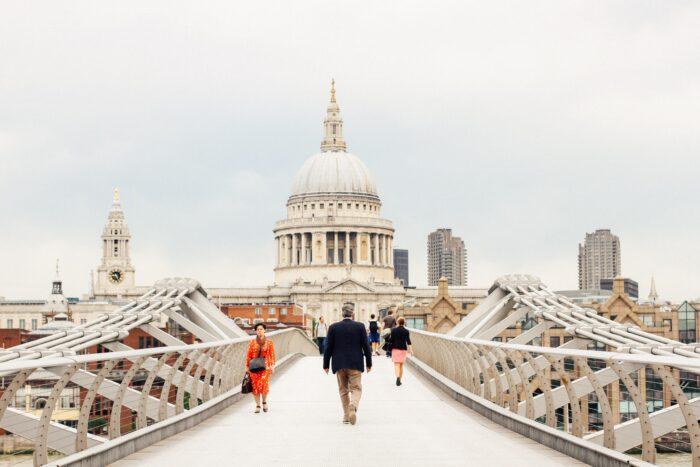People walking towards St Pauls across Millennium Bridge