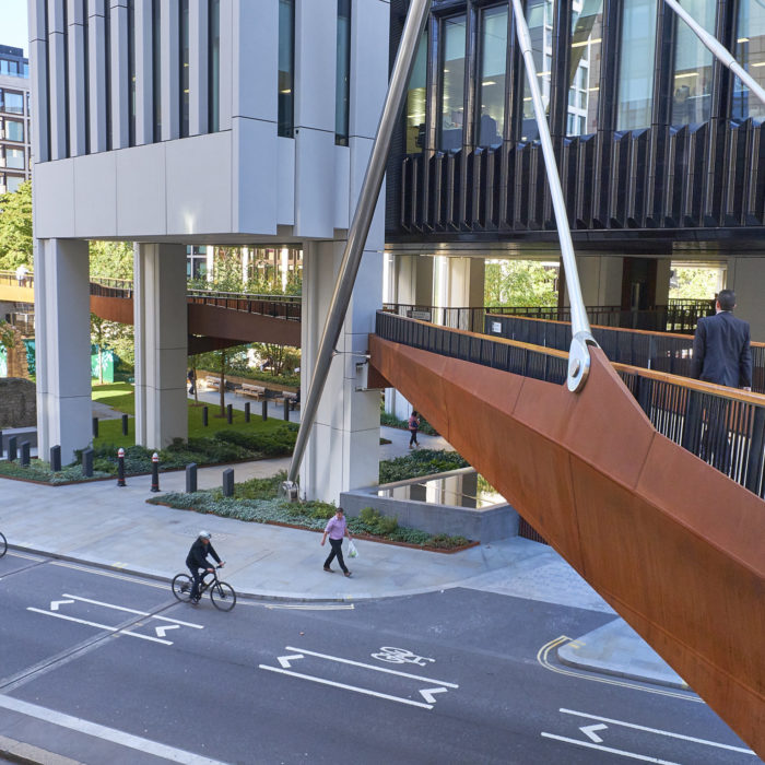 A photo of a section of a highwalk bridge, which passes over London Wall Street in the City of London.