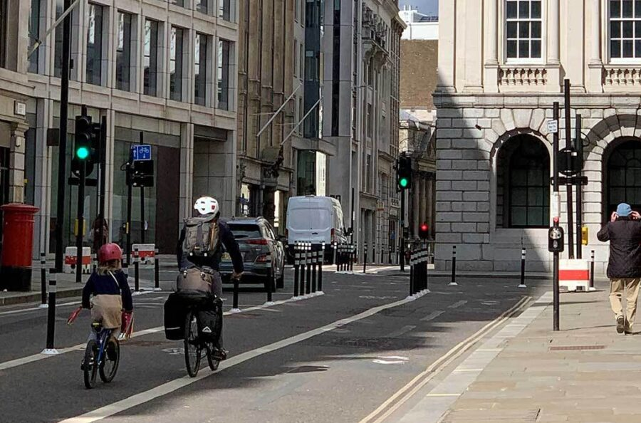 Photo of a father and daughter cycling in the City of London