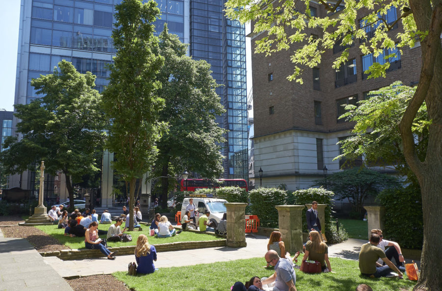 Image of people taking some time away from their desks to eat lunch in the gardens of the City.